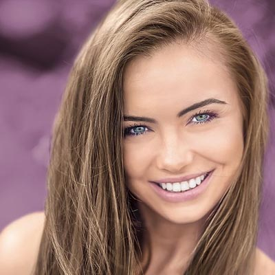 Young happy smiling woman outdoor portrait ; Shutterstock ID 219076699